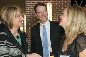 Patti greets Rusty Shelton of Shelton Media and Paige.